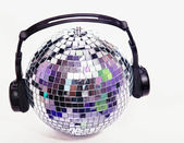 Disco ball with head phones — Stock Photo