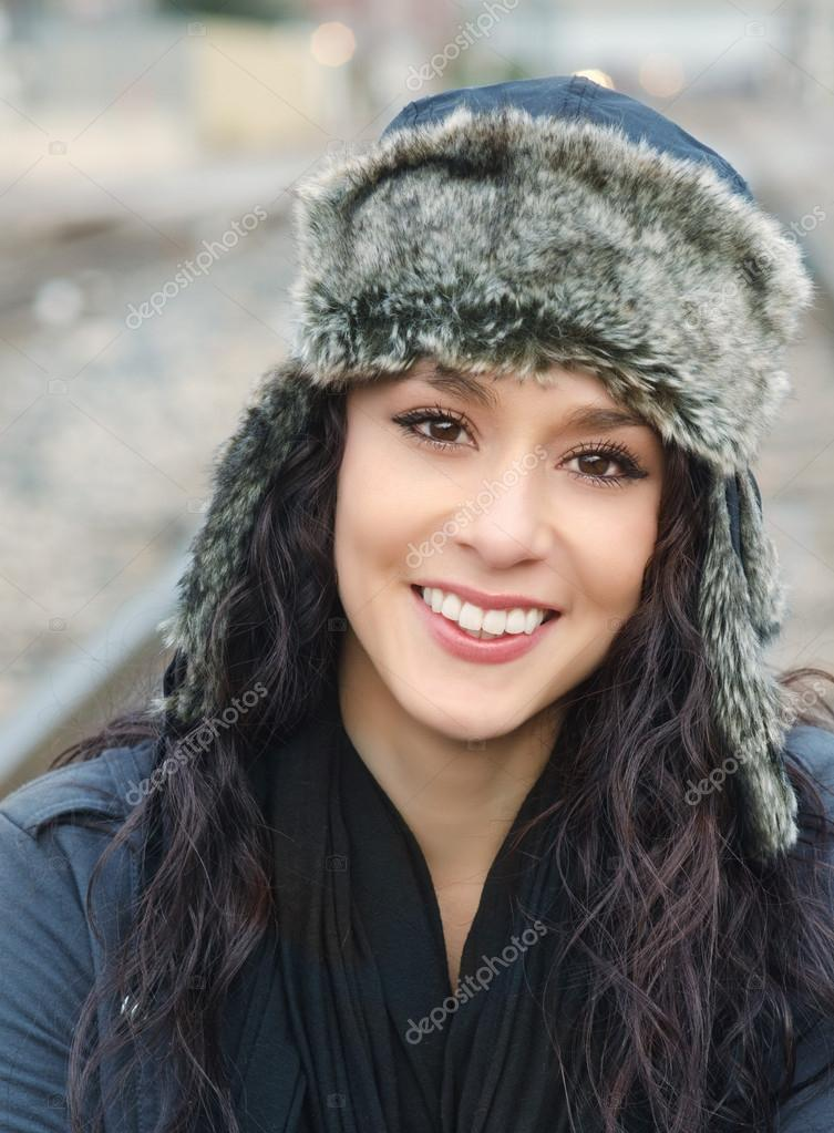 Portrait of a beautiful smiling young woman wearing wool hat — Stock Photo #17850161