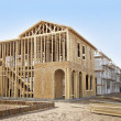 图库照片: New home construction framing