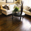 Hard wood flooring in living room area - Stock Photo