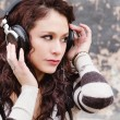 Woman listening to music head phones — Stock Photo