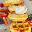 Belgium waffles and fruit breakfast - Stock Photo