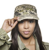 Attractive young woman wearing military cap — Stock Photo