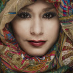 Beautiful young woman wearing head scarf — Stock Photo