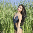 Exotic beautiful woman in tropical beach location — Stock Photo