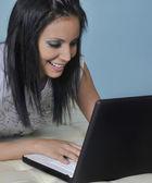Woman having fun on laptop computer — Stock Photo