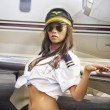 Young woman posing in Airline crew uniform — Stock Photo #25157905