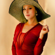 Elegant young woman wearing summer hat — Stock Photo