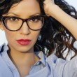 Woman wearing retro vintage eye glasses — Stock Photo