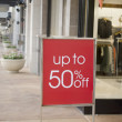 Sale sign outside fashion retail store in shopping mall  — Stock Photo