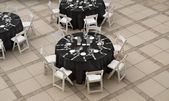 Banquet table and chairs with silver wear placement — Stock Photo