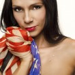 Beautiful sexy woman holding American flag — Stock fotografie
