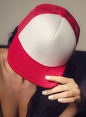 Sexy woman wearing baseball cap — Stock Photo
