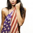 Beautiful woman wrapped in American flag — Stock Photo