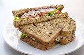 Turkey meat deli sandwich on plate — Stock Photo