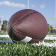 Stock Photo: AmericFootball field with ball