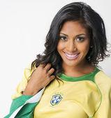 Beautiful smiling Brazil soccer fan — Stock Photo