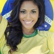 Happy smiling Brazil soccer football fan — Stockfoto