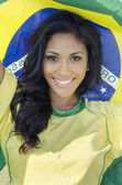 Happy smiling Brazil soccer football fan — Stock Photo