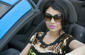 Beautiful elegant woman driving covertible car — Stock Photo