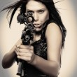 Sexy woman holding weapon gun rifle — Stock Photo #36927373