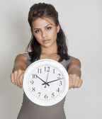 Young woman holding clock — Stock Photo
