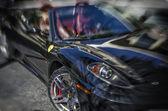 Feb,2014: Ferrari is an Italian sports car manufacturer based in Maranello, Italy, — Stock Photo