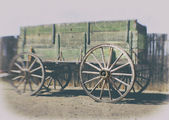 Grunge style old wild west Pioneer wagon wheel — Stock Photo