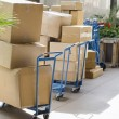 Delivering cargo boxes from truck to business — Stock Photo