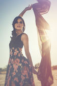 Woman in dress with sun flare — Stock Photo