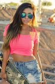 Beautiful young woman holding skateboard — Stock Photo