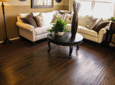 Hard wood flooring in liven room den new home — Stock Photo