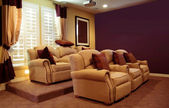 View of an entertainment room with cozy seats and lit lights — Stock Photo