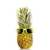 Pineapple wearing sunglasses — Stock Photo