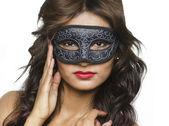 Beautiful woman wearing mask — Stock Photo