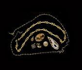 Gem stones gold necklace design choices — Stock Photo