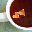 Hearts of mandarin in tea cup - Stock Photo