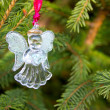 Glass angel on fir-tree — Stock Photo