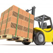Forklift with hollow clay blocks - Stock Photo