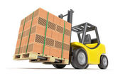 Forklift with hollow clay blocks — Stock Photo