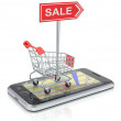 Shopping cart with smartphone — Stock Photo #16971385