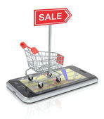 Shopping cart with smartphone — Stock Photo