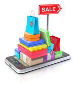 Smartphone with shopping stuff, GPS map and signpost — Stock Photo