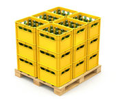 Drink crates on the wooden pallet — Stock Photo