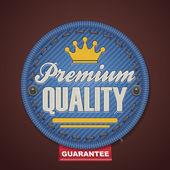 Distintivo di vettore premio qualità tessuto — Vettoriale Stock