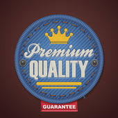 Vector premium quality fabric badge — ストックベクタ