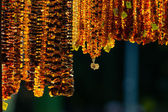 Amber jewelry in shop — Stock Photo