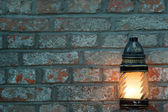 Candle on a brick background with text space — Stock Photo