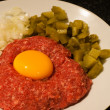 Raw beef tatar meet with egg yolk on it — Stock Photo