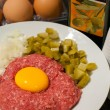 Stock Photo: Raw beef tatar meet with egg yolk on it
